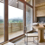 mass timber table and chairs with balcony