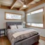 modern wood design grey bedroom with timber ceiling