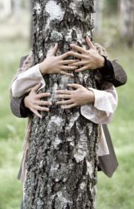 people showing love of wood by hugging a tree
