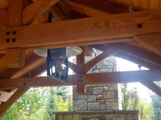 timberframe roof and stoneoven