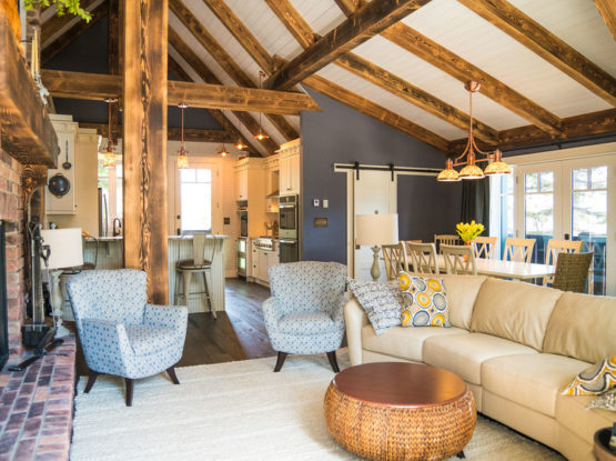open floor plan timber frame beams on walls and in the ceiling