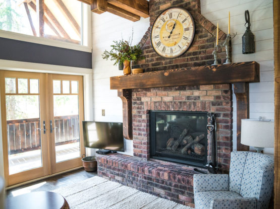 textured timber mantel on a brick fire place