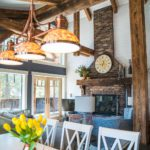 brick fireplace and timber details in an mountain modern family home