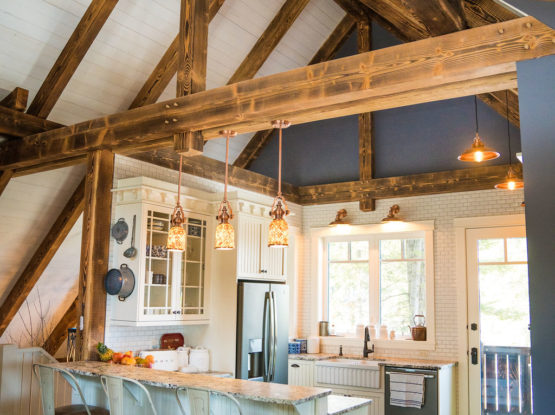 dark timber beams and trusses in a contemporary kitchen